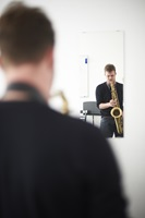 Saxophone student while rehearsing.