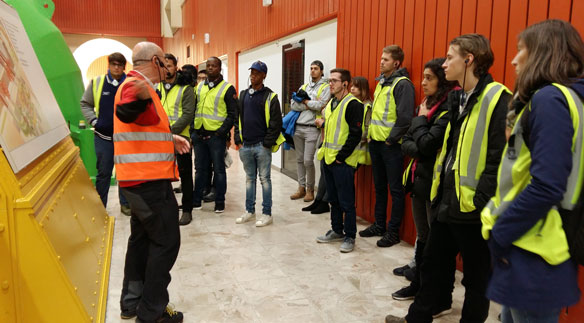 The students of BSc Energy Systems Engineering listen fascinated to the explanations about the turbines of the Grimsel hydro power plant.