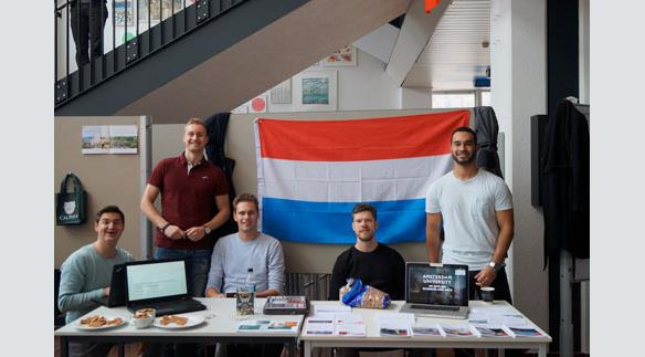 The dutch students presenting their programs at home and some typical dutch food.