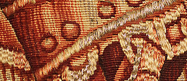Detail of a textile red and orange